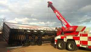 Trailer rollover recovery using recovery boom
